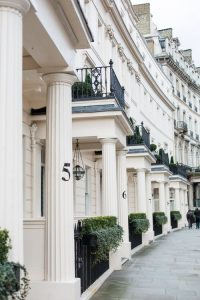 street of white houses in Kensington, London